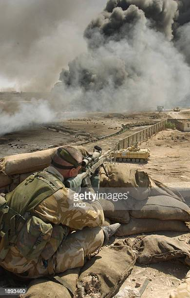 In this hand out image by the British Defence Ministry Lance Sergeant Chris Briggs serves as a sniper with Support Company attached to Number 1...