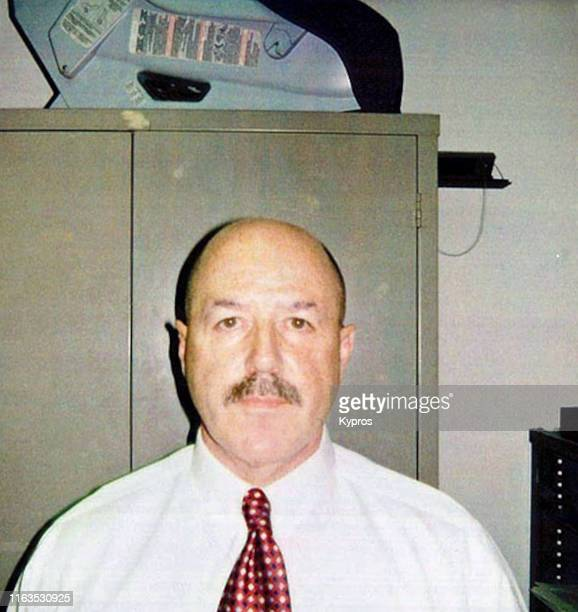 In this handout, American police officer, consultant and convicted felon Bernard Kerik in a mug shot, New York City, US, June 2006.