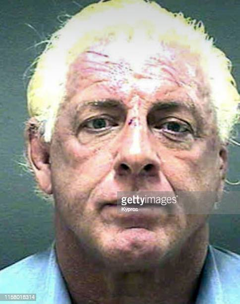 In this handout, American professional wrestling manager and professional wrestler Ric Flair following his arrest in North Carolina, December 2005.