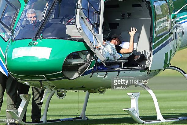 In this handout Brazil's Neymar is seen inside a medical helicopter at the Granja Comary training center on July 05 2014 in Teresopolis Brazil Neymar...