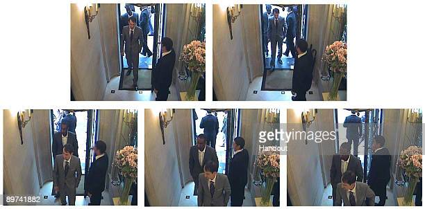 In this handout composite image from the Metropolitan Police obtained August 11 two thieves dressed in suits enter Graff Jewellers August 6 2009 in...