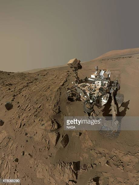 In this handout composite provided by NASA/JPLCaltech/MSSS NASA's Curiosity Mars rover used the camera at the end of its arm in April and May 2014 to...