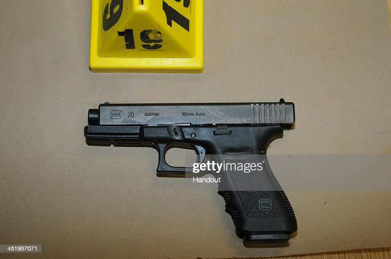 In this handout crime scene evidence photo provided by the Connecticut State Police, shows a Glock 20, 10mm found near the shooter in Room 10 at Sandy Hook Elementary School following the December 14, 2012 shooting rampage, taken on an unspecified date in Newtown, Connecticut . A report was released November 25, 2013 by Connecticut State Attorney Stephen Sedensky III summarizing the Newtown school shooting that left 20 children and six women dead inside Sandy Hook Elementary School. According to the report, a motive behind the shooting by gunman Adam Lanza is still unknown.