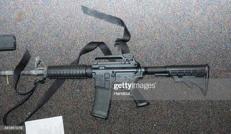 In this handout crime scene evidence photo provided by the Connecticut State Police, shows a Bushmaster rifle in Room 10 at Sandy Hook Elementary School following the December 14, 2012 shooting rampage, taken on an unspecified date in Newtown, Connecticut . A report was released November 25, 2013 by Connecticut State Attorney Stephen Sedensky III summarizing the Newtown school shooting that left 20 children and six women dead inside Sandy Hook Elementary School. According to the report, a motive behind the shooting by gunman Adam Lanza is still unknown.