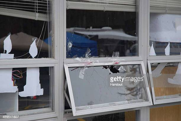 In this handout crime scene evidence photo provided by the Connecticut State Police, shows a damaged window at the Sandy Hook Elementary School...