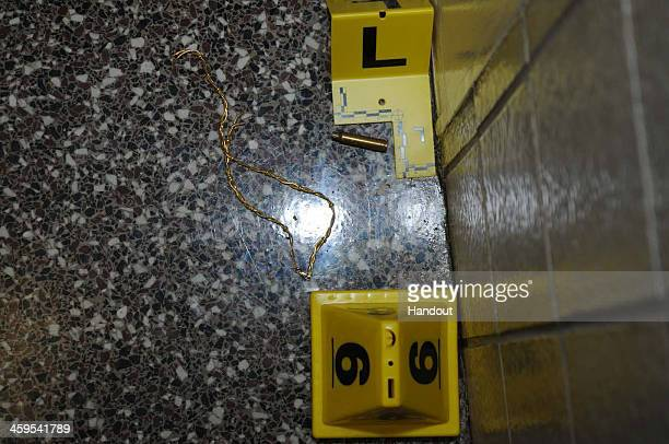 In this handout crime scene evidence photo provided by the Connecticut State Police, shows a bullet casing at Sandy Hook Elementary School following...
