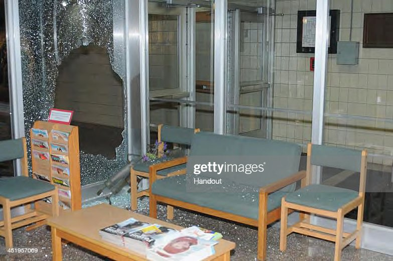 In this handout crime scene evidence photo provided by the Connecticut State Police, shows damage done inside the front entrance at Sandy Hook Elementary School following the December 14, 2012 shooting rampage, taken on an unspecified date in Newtown, Connecticut . A report was released November 25, 2013 by Connecticut State Attorney Stephen Sedensky III summarizing the Newtown school shooting that left 20 children and six women dead inside Sandy Hook Elementary School. According to the report, a motive behind the shooting by gunman Adam Lanza is still unknown.
