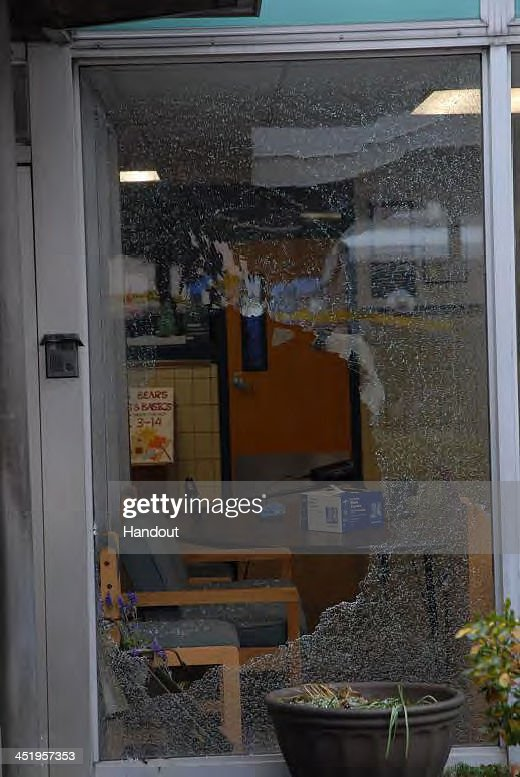 In this handout crime scene evidence photo provided by the Connecticut State Police, shows damage done to the front entrance at Sandy Hook Elementary School following the December 14, 2012 shooting rampage, taken on an unspecified date in Newtown, Connecticut . A report was released November 25, 2013 by Connecticut State Attorney Stephen Sedensky III summarizing the Newtown school shooting that left 20 children and six women dead inside Sandy Hook Elementary School. According to the report, a motive behind the shooting by gunman Adam Lanza is still unknown.