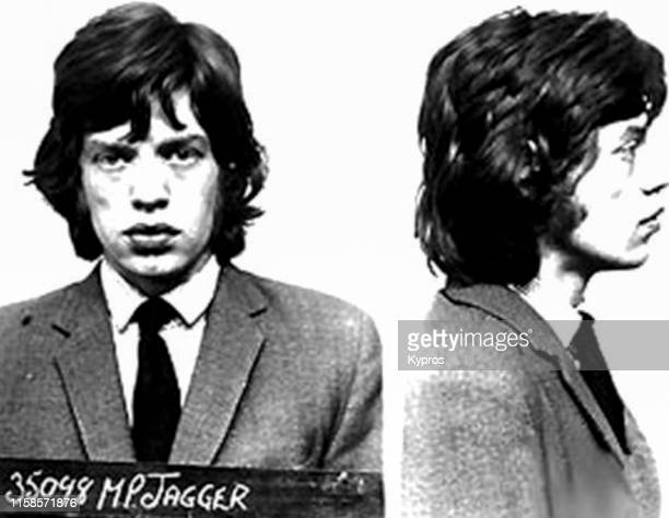 In this handout English singer songwriter actor and film producer Mick Jagger in a mug shot at Brixton Jail London UK 1967