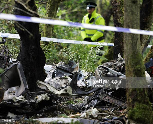 In this handout file photo issued by Strathclyde Police the scene of the crash after the helicopter in which Colin McRae was flying crashed is seen...