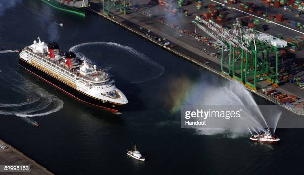 In this handout from Disney Cruise Line surrounded by Los Angeles Fire and Coast Guard boats the cruise ship 'Disney Magic' a 2700 passenger ship...