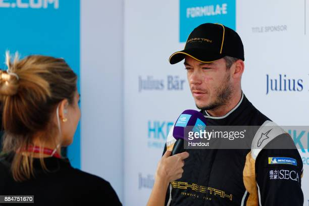 In this handout from FIA Formula E Andre Lotterer TECHEETAH Renault ZE 17 talks to TV Presenter Nicki Shields during the Hong Kong ePrix Round 2 of...