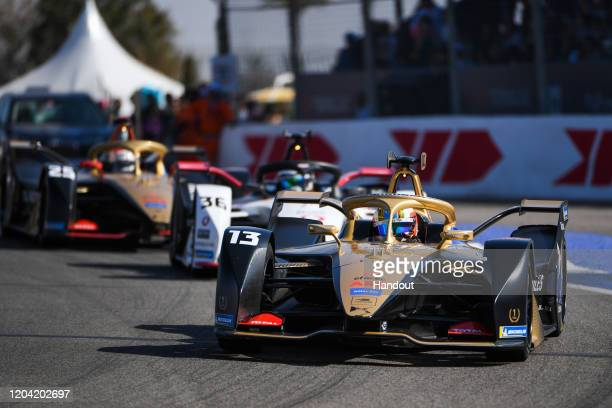 In this handout from FIA Formula E Antonio Felix da Costa DS Techeetah DS ETense FE20 leads Andre Lotterer Tag Heuer Porsche Porsche 99x Electric and...