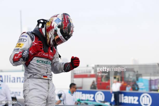 In this handout from FIA Formula E Daniel Abt Audi Sport ABT Schaeffler Audi etron FE04 celebrates after winning the race during the Hong Kong ePrix...