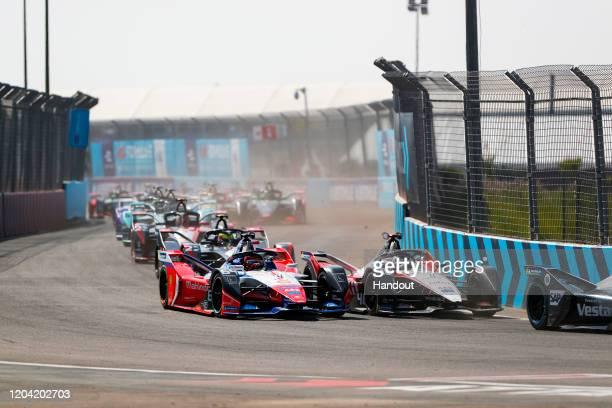 In this handout from FIA Formula E Edoardo Mortara Venturi EQ Silver Arrow 01 side by side with Jérôme d'Ambrosio Mahindra Racing M6Electro on...