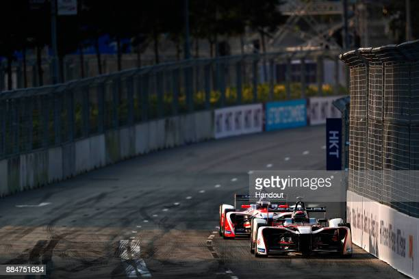 In this handout from FIA Formula E - Edoardo Mortara Venturi Formula E, Venturi VM200-FE-03, leads Nick Heidfeld , Mahindra Racing, Mahindra...