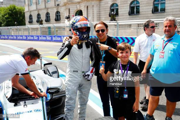 In this handout from FIA Formula E Emerson Fittipaldi former F1 World Champion and Indy 500 winner drives the Formula E car with Felipe Massa ex...