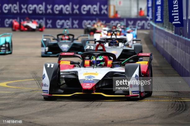 In this handout from FIA Formula E - Lucas Di Grassi , Audi Sport ABT Schaeffler, Audi e-tron FE05, leads Sébastien Buemi , Nissan e.Dams, Nissan...