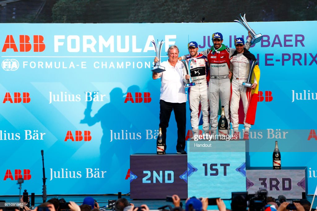 In this handout from FIA Formula E - Lucas Di Grassi of Brazil and Audi Sport ABT Schaeffler, Audi e-tron FE04, wins the Zurich ePrix, with Sam Bird (GBR), DS Virgin Racing, DS Virgin DSV-03, in and Jerome d'Ambrosio (BEL), Dragon Racing, Penske EV-2, in 3rd. during the Zurich E-Prix on June 10, 2018 in Zurich, Switzerland.