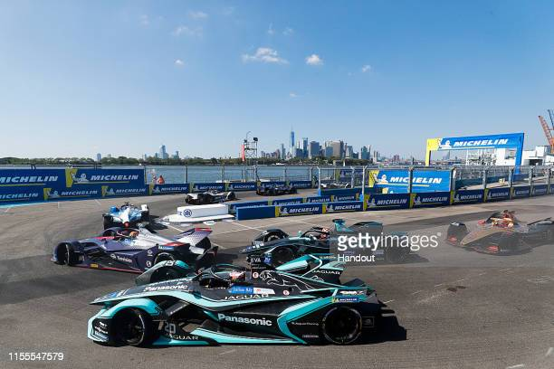 In this handout from FIA Formula E Robin Frijns Envision Virgin Racing Audi etron FE05 leads Mitch Evans Panasonic Jaguar Racing Jaguar IType 3 and...
