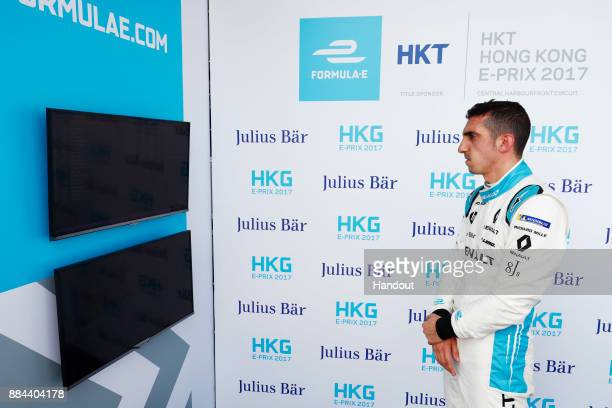 In this handout from FIA Formula E Sebastien Buemi Renault eDams Renault ZE 17 watches the screens during qualifying during the Hong Kong ePrix Round...