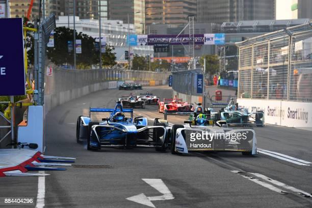 In this handout from FIA Formula E Sebastien Buemi Renault eDams Renault ZE 17 battles with Lucas Di Grassi Audi Sport ABT Schaeffler Audi etron FE04...