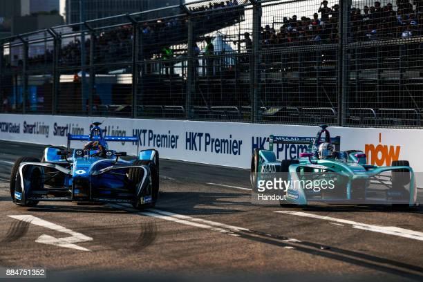 In this handout from FIA Formula E Sebastien Buemi Renault eDams Renault ZE 17 leads Kamui Kobayashi MS AD Andretti Formula E Andretti ATEC03 during...