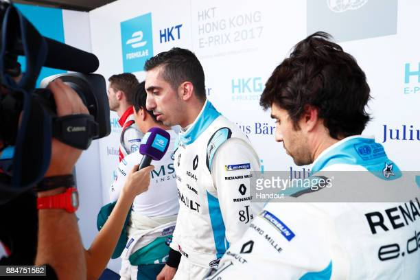 In this handout from FIA Formula E Sebastien Buemi Renault eDams Renault ZE 17 talks to the media during the Hong Kong ePrix Round 2 of the 2017/18...