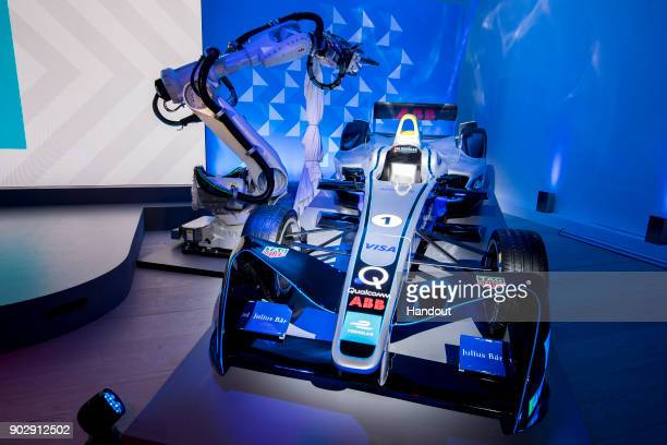 In this handout from FIA Formula E The newlybranded Formula E car is unveiled by an ABB IRB6700 robot during a press conference at the Saatchi...
