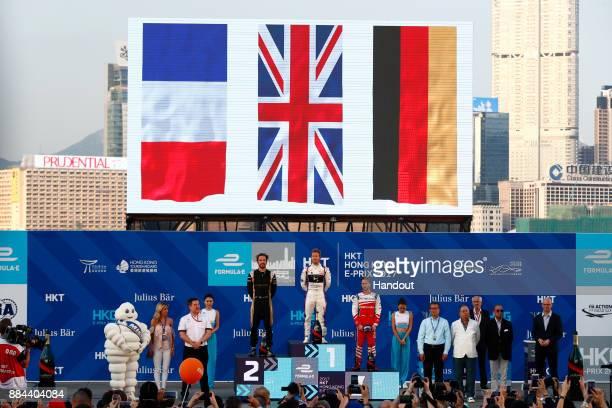 In this handout from FIA Formula E Winner Sam Bird DS Virgin Racing DS Virgin DSV03 celerates on the podium with Jean Eric Vergne TECHEETAH Renault...