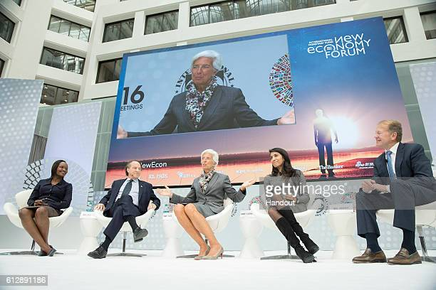 In this handout from IMF International Monetary Fund Managing Director Christine Lagarde joins John Chambers Chairman of the Board Cisco Systems...