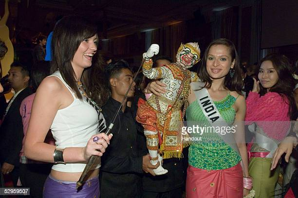 In this handout from Miss Universe LP LLLP Mary Gormley Miss Ireland 2005 and Amrita Thapar Miss India 2005 pose with a Thai puppet at the BSC...