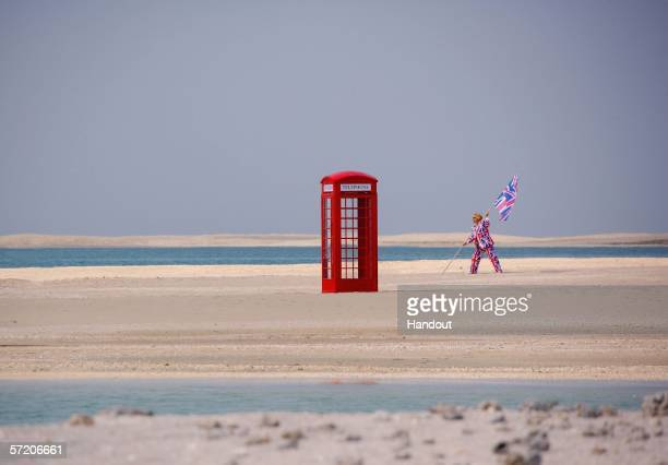 In this handout from Nakheel Co LLC Sir Richard Branson poses next to a phone box during a photocall on the manmade island known as 'United Kingdom'...