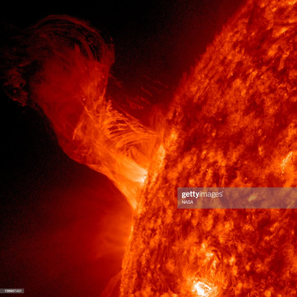 In this handout from NASA, a solar eruption rises above the surface of the sun December 31, 2012 in space. According to NASA the relatively minor eruption extended 160,000 miles out from the Sun and was about 20 times the diameter of Earth.