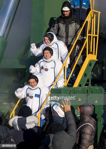 In this handout from NASA Expedition 54 flight engineer Scott Tingle of NASA top flight engineer Norishige Kanai of Japan Aerospace Exploration...