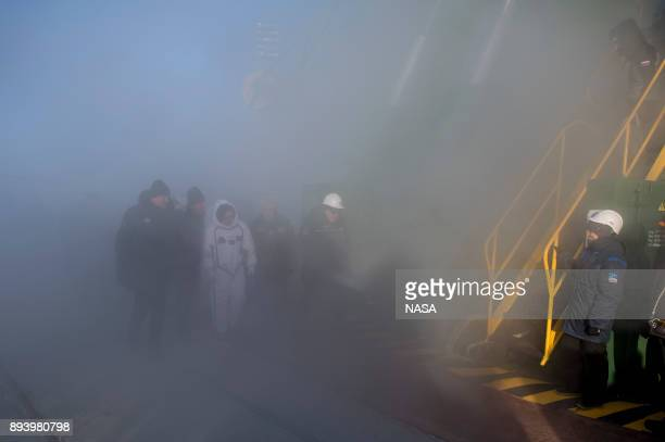 In this handout from NASA Expedition 54 Soyuz Commander Anton Shkaplerov of Roscosmos is seen as he is escorted to the base of the Soyuz rocket prior...