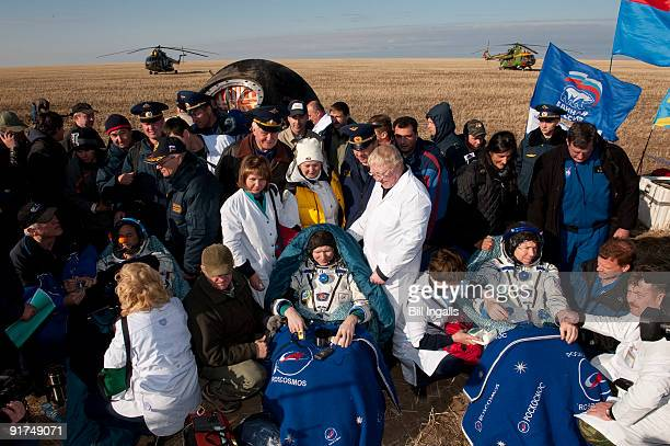 In this handout from NASA Seated left to right Spaceflight participant Guy Lalibert Expedition 20 Commander Gennady Padalka Expedition 20 Flight...