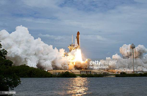In this handout from NASA, Space shuttle Atlantis blasts off from launch pad 39A at Kennedy Space Centern July 8, 2011 in Cape Canaveral, Florida....