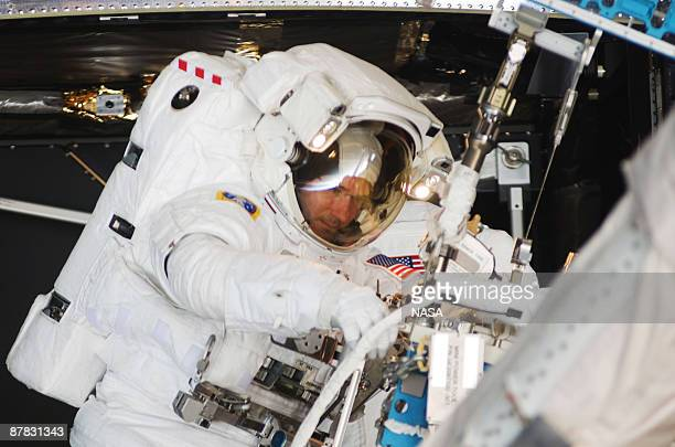 In this handout from NASA STS125 mission specialist astronaut Michael Good participates in the mission's fourth spacewalk to repair the Hubble Space...