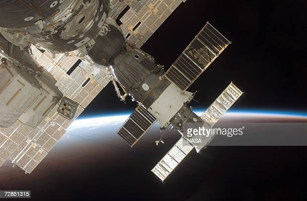 In this handout from NASA The docked Soyuz 13 and Progress 22 resupply vehicle are seen attached to the International Space Station December 17 2006...