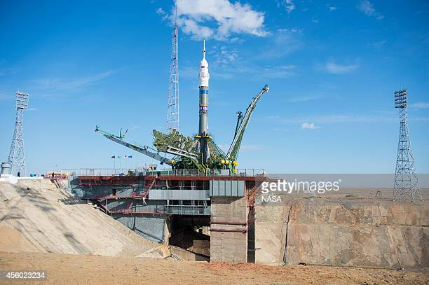 In this handout from NASA the gantry arms begin to close around the Soyuz TMA14M spacecraft on the launch pad September 23 2014 at the Baikonur...
