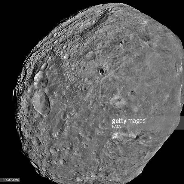 In this handout from NASA the giant asteroid Vesta is seen in an image taken from the NASA Dawn spacecraft about 3200 miles above the surface July 24...