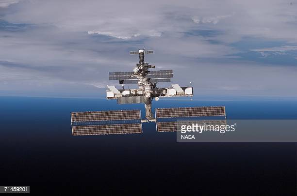 In this handout from NASA, The International Space Station is seen as the Space Shuttle Discovery moves away during undocking July 15, 2006 in space....