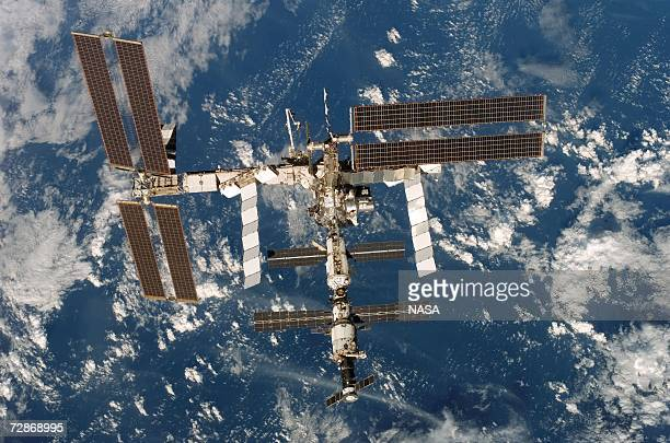 In this handout from NASA the International Space Station is seen from the Space Shuttle Discovery after undocking from the station December 19 2006...