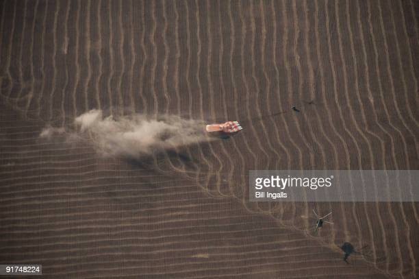 In this handout from NASA The Soyuz TMA14 spacecraft lands with Expedition 20 Commander Gennady Padalka Flight Engineer Michael Barratt and...