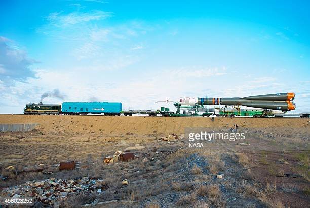 In this handout from NASA the Soyuz TMA14M spacecraft is rolled out to the launch pad by train September 23 2014 at the Baikonur Cosmodrome in...