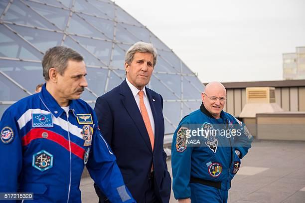 In this handout from NASA US Secretary of State John Kerry center meets with Roscosmos cosmonaut Mikhail Kornienko left and NASA astronaut Scott...