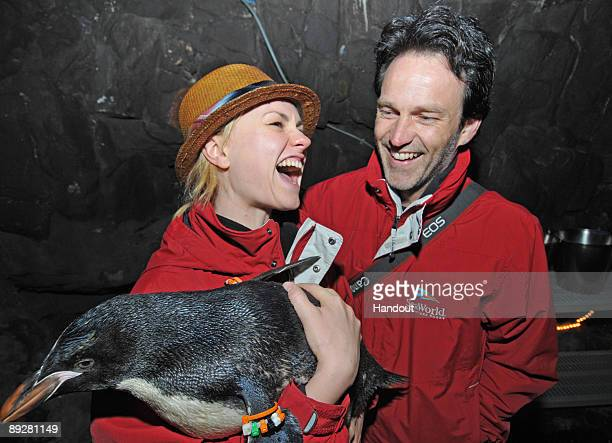 In this handout from SeaWorld San Diego 'True Blood' costars Anna Paquin and Stephen Moyer hold a macaroni penguin chick at SeaWorld San Diego's...