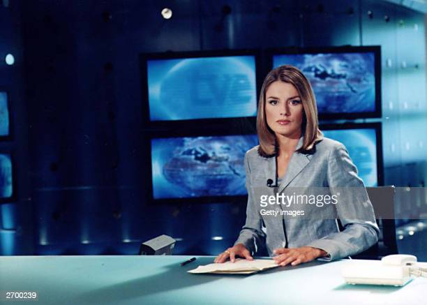 In this handout from Television Espanola Spanish television journalist Letizia Ortiz Rocasolano sits at a desk Her engagement to Spain's heir Prince...