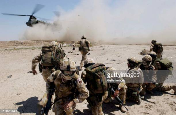 In this handout from the British Army, soldiers from the The Royal Welch Fusiliers mount helicopter borne Eagle VCP's , July 2, 2004 around the...